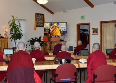 Nuns watching teaching by His Holiness the Dalai Lama.
