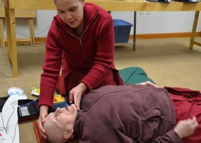 Nun learns CPR.