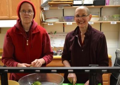 Nuns prepare vegetables for lunch.
