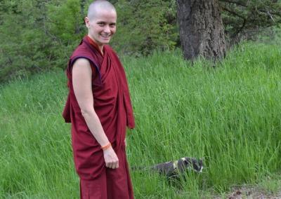 Nun walks cat.