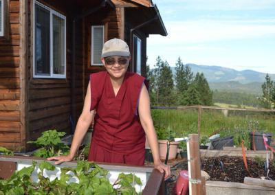 Nun tends vegetable garden.