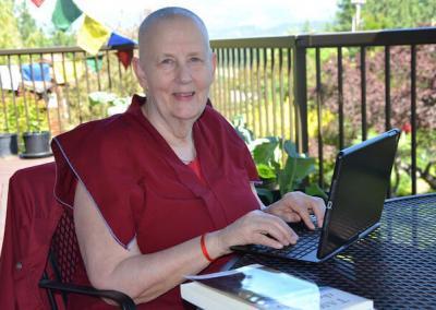 Nun teaches on computer.