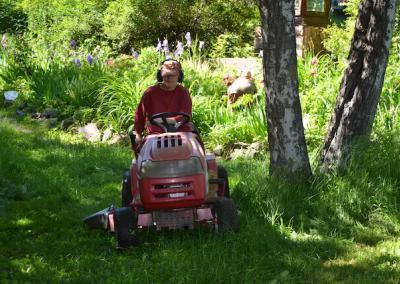 Nun mows grass.