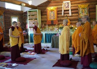 Nuns perform puja for COVID victims.