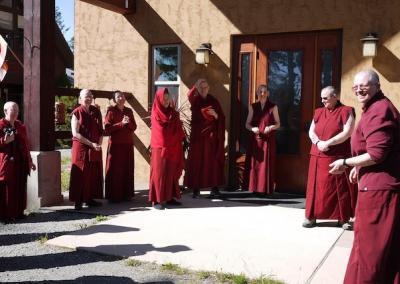Nuns say goodbye to a nun leaving for a retreat.