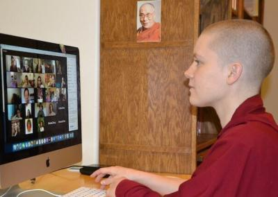 Nun on computer.