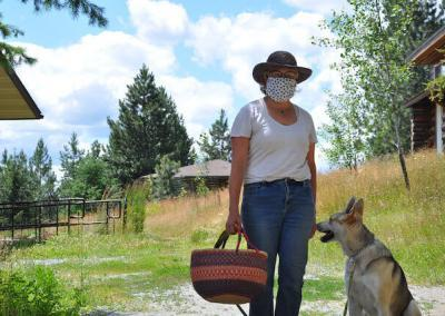 Woman and dog give fresh bread to Abbey.