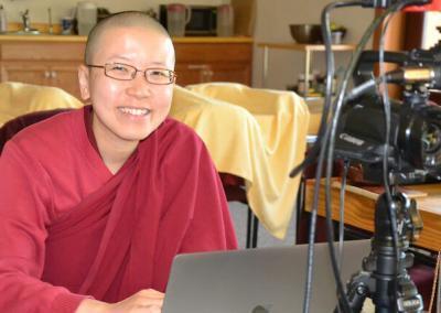 Nun operates camera.