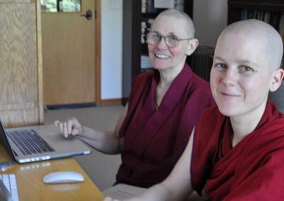 Nuns on computer.