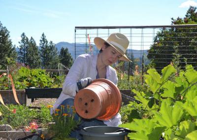 Woman pots soil.