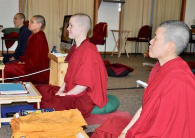 Nuns and trainee listen to teachings.