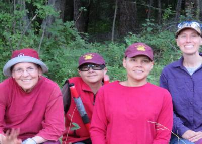 Nuns and trainee work in forest.