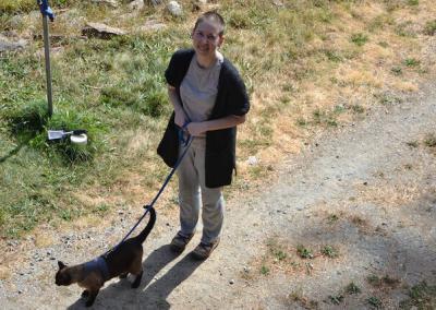 Woman walks cat.