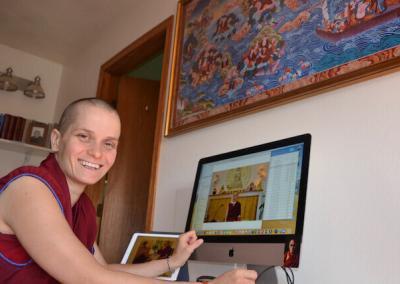 Nun makes photo gallery on website.