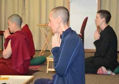 Nuns and trainees pray.