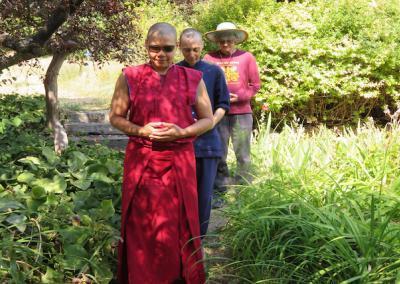 Nun leads walking meditation.