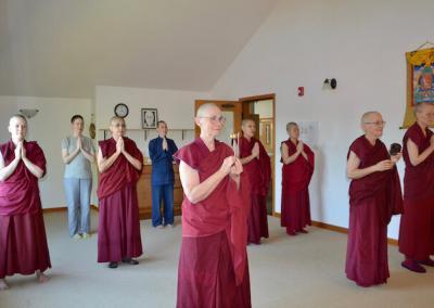 Nuns do prostration ceremony.