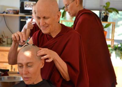Preceptor shaves nun's head.