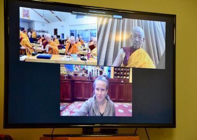 Sangha greets teacher and translator.