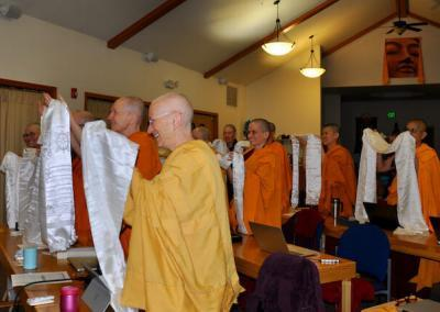 Nuns offer scarf to teacher.