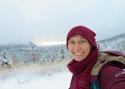 Nun in snowy forest.