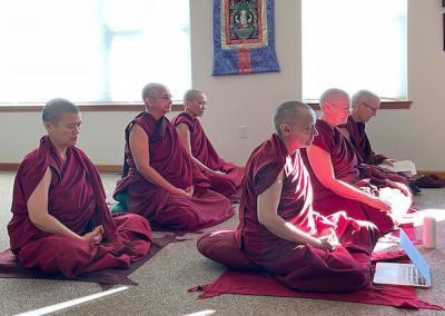 Nuns meditate.