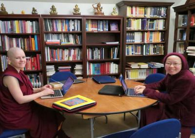 Nuns study in library.