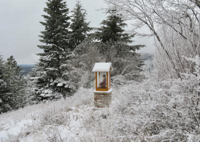 Buddha house on a snow-covered hillside.