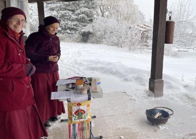 Two nuns stand outside.