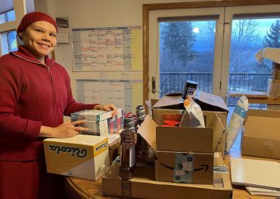 Nun opens boxes.
