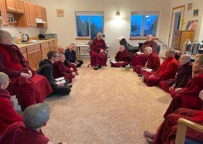 Abbey community meets in Abbess' cabin.