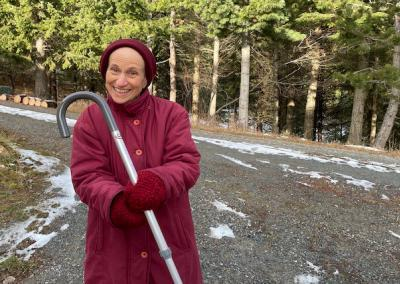 Abbess walks without cane.