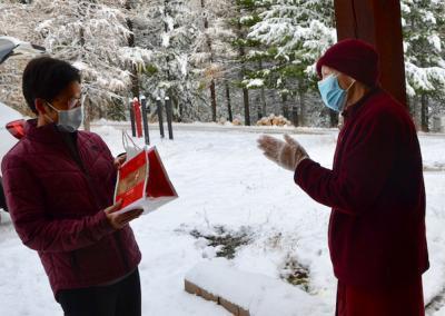 Nun gives present to woman.
