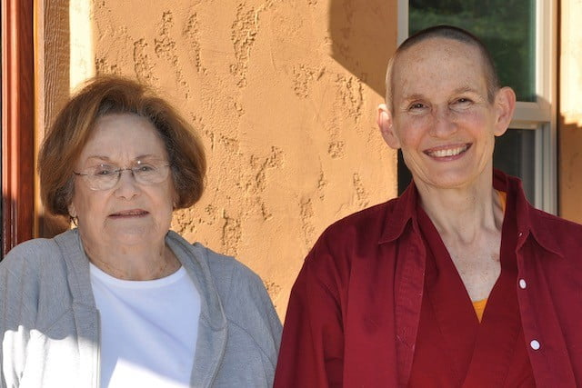Older woman side by side with nun.