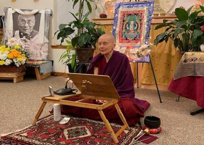 Nun leads Chenrezig Buddha practice.