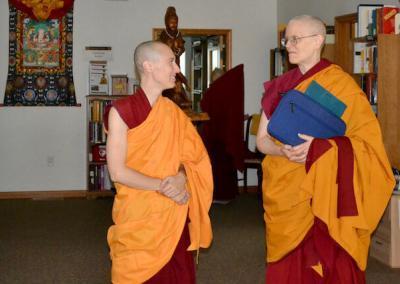 Nuns discuss teachings.