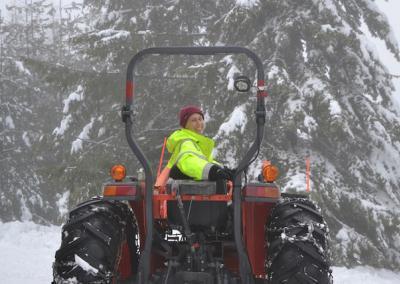 Nun drives snow plow.