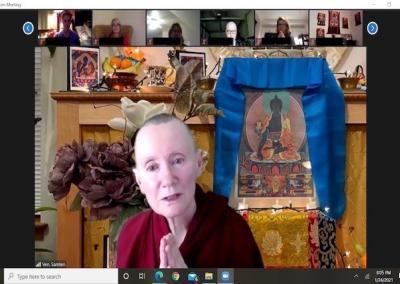 Nun prays for sick with Medicine Buddha.