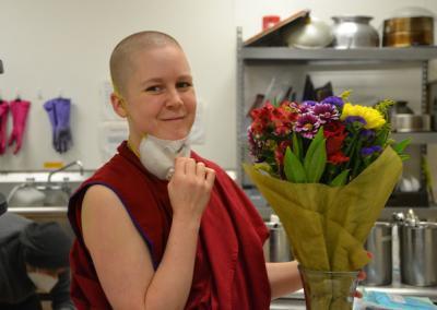 Nun holds flowers.