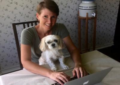 Woman and dog on computer.