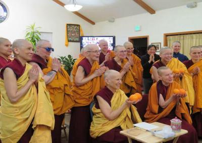 Monastics offer oranges and say goodbye