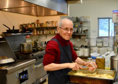 Nun prepares food in kitchen