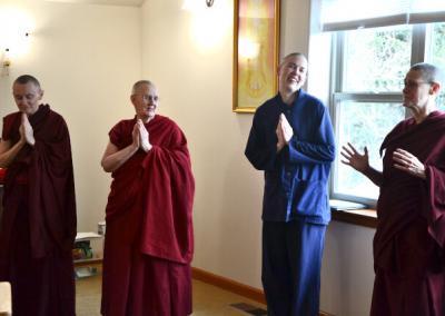 Nun talks while 3 people listen