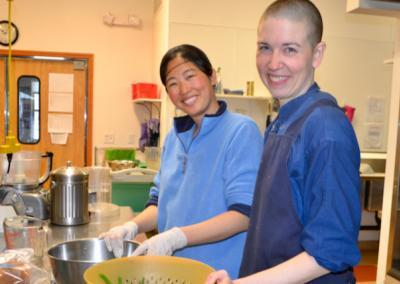 Woman and monastic trainee cook.