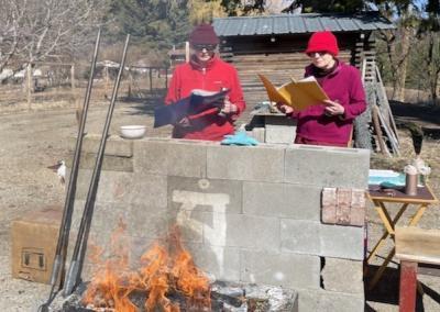 Nuns do fire puja.