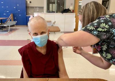 Nun receives vaccine while wearing mask