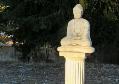 Buddha statue on pedestal