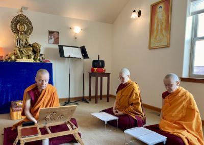 3 nuns sit near altar