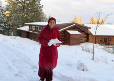 Smiling nun in snow
