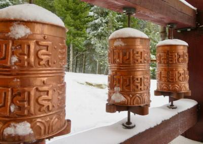 Snow-covered prayer wheels